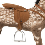 Diesel comes with a removable saddle with metal stirrups